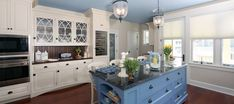 Custom Kitchen featuring white painted perimeter cabinetry with custom blue painted island.  Located in Longport, NJ.  Kitchen Design by Churchville Kitchen & Home Design in Bucks County, PA.