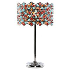 The Fairlea Jeweled Table Lamp displays stunning craftsmanship and whimsical artistry. The sleek chrome base is topped by a vintage-inspired crystal shade for an eye-catching look that would enhance both classic and contemporary interiors.