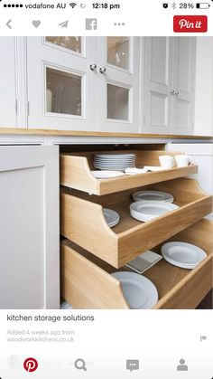 I like the cupboard doors and big roll-out shelves.   Need to measure space required for china.