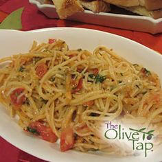 Angel Hair Pasta with Tomato and Black Olive Sauce  