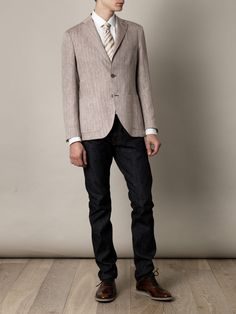 Brown and white linen jacket with notch lapels and a two button front fastening. The classic herringbone blazer gets the Mr Rick Tailor makeover with this single-breasted style. A slim streamlined fit with all the labels' signature details, layer over dapper denim and smart shirting for a contemporary Summer look.  Shown here with Gucci Diagonal-stripe tie, Churchs Hirst shoes, Valentino Poplin polo shirt and J Brand Kane straight-leg jeans.