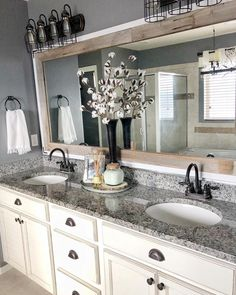 Updated Bathroom Mirrors – How to make your builder grade bathroom mirror look like a custom upgrade! Updated Bathroom Mirrors – How to make your builder grade bathroom mirror look like a custom upgrade! Bathroom Vanity Makeover, Bathroom Vanities, Bathroom Cabinets, Vanity Redo, Bathroom Makeovers, Shower Makeover, Bathroom Hardware, Kitchen Cabinets, Bathroom Mirror Redo
