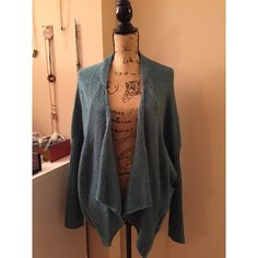 NWT oversized drape cardigan NWT. Amazing cardigan with unique design. Slight Slit on the back. Pocket design. Quality is wonderful. Pretty color- kind of like a shade of soft teal, blue green, or jade. Brand is Romeo and Juliet Couture. Free people for exposure Free People Sweaters Cardigans