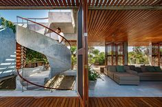 In this beach house, a series of wood doors on hinges separate outdoor and indoor spaces, and have slats that offer shade sunlight and allow for natural ventilation. Tulum, Riviera Maya, Archdaily Mexico, House Cast, Beachfront House, Storey Homes, Loft, Ground Floor Plan, Los Angeles Homes