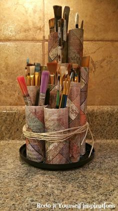 Paint Brush Holder: Recycled Paper Rolls: Easy Peasy to make for storage of all heights of paint brushes.