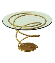A mesa Double Helix tem base em aço inox banhado a ouro 24k e tampo de vidro. A peça é um dos móveis projetados por Brad Pitt e executados pela empresa norte-americana Pollaro Custom Furniture. Cada peça da coleção Pitt-Pollaro (www.pitt-pollaro.com) é confeccionada manualmente