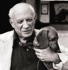 Picasso and his dachshund named Lump photographed by David Douglas Duncan