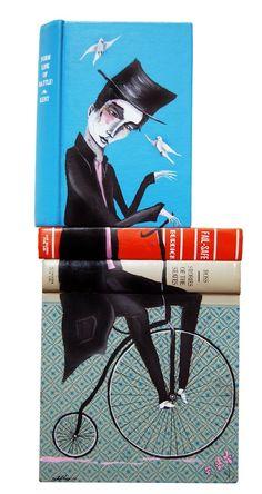 Mike Stilkey, Birds Attack Man on Bike, 2010. Acrylic on books.