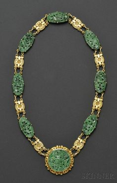 Striking Art Deco 14kt Gold and Jadeite Necklace, composed of jadeite plaques carved to depict foliage and birds, interspersed with foliate motif links, central plaque converts to a brooch, lg. 16 in.