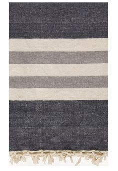 "Our soft Turkish cotton grey throw blankets in favorite lake stripes are a classic. Understated and stylish, charcoal grey is accented by ivory and light grey stripes. - 50"" x 70"" - 100% cotton - Soli"