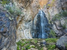 Cattail Falls Trail at Big Bend National Park You won't find this trail on the map, and you won't hear it advertised anywhere, so it's a true hidden oasis in the otherwise arid land. After heavy rainfall, the waterfall at top of the trail will cascade over the canyons, making the grueling trek totally worth it. Pictured above is the waterfall in early spring.
