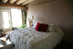 Corner Cottage Earthship master bedroom