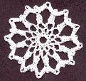 Free thread crochet pattern: Christmas snowflake ornament or gift tag