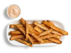 Perfect French Fries Recipe  2 1/2 pounds potatoes  Vegetable or peanut oil, for frying  Sea salt, for sprinkling  Ketchup and mayonnaise, mixed, for serving