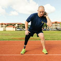 Naval Aircrewman (Mechanical) Airman Brett Parks prepares to throw a shot put during a training exercise for the Wounded Warrior Pacific Inv...