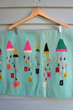 Use a pretty hanger to display artsy fabric (and cover up a drab door)