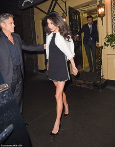 Helping hand:Being a the gentlemen you would expect the actor to be, the Ocean's 11 star led the way out of the restaurant before stopping and escorting his wife to the car