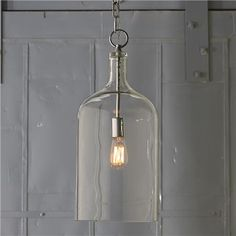"Glass Jug Lantern  The look is repurposed-vintage charm with modern flair, as one socket is suspended in the center of a clear glass jug. Polished nickel hardware. Add a vintage ""Edison"" bulb for even more style.   150 watts (medium base socket).  (22.75""Hx10""W)  6' chain  5"" canopy"