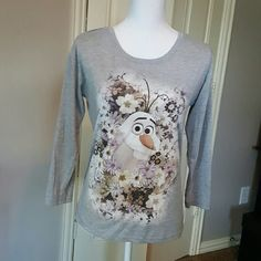 Holiday Olaf long sleeve T-shirt Celebrate the holidays with Olaf from Disney's Frozen. His adorable face is framed by flowers on this long sleeve T-shirt. Size medium from Juniors department at Kohls. No holes or stains. Normal gentle wear.  *Please use offer button to negotiate. REASONABLE offers only please. 10% off 2 or more bundled items! Tops Tees - Long Sleeve