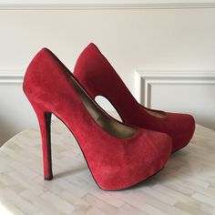 """Steve Madden Red Suede Heels Stand out in these red high heels. Genuine suede. 5"""" heel with a 1.5"""" hidden platform. Only worn a couple of times. Small wear/mark on the back of the right heel (shown in 3rd picture). Excellent condition otherwise. Steve Madden Shoes Heels"""