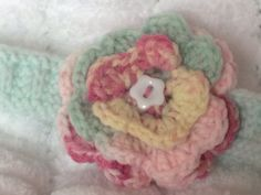 Hand Knitted Baby Headband with Crochet Flower by Snugglescuddles, £10.00