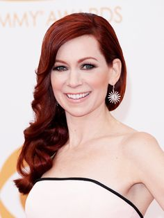 """Carrie Preston on her red hair: """"This color is custom made for me. I do it here in Los Angeles at Gavert Atelier and in New York at Angelo David Salon. And they both have the same formula, but I don't think they have ever given it to anybody else, though. The shine is what they came up with for True Blood. Gavert, who first turned me red, came up with the formula, and then you have to go every three weeks."""""""