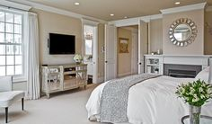 This bedroom's silver accent furniture is completely on trend. Bellevue, WA Coldwell Banker BAIN