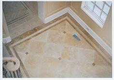 Custom tile floor. http://www.jpmoorehomeimprovements.com/our-services/bathroom-remodeling/