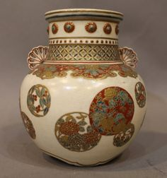A Japanese imperial Satsuma vase decorated with circular panels