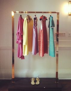 Love these brightly colored frocks and the amazing brass garment rack they are hanging on!