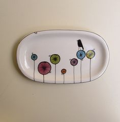 This design is really cute and different. Definitely needs to go on my wishlist. The artist is Catherine Reece. http://www.etsy.com/listing/91699303/ceramic-colorful-black-bird-tray-for-her Great Mother's Day gift.