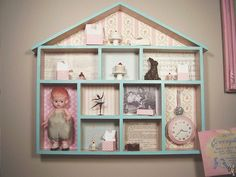 We love how you can find so many great things on Flickr, from beautiful rooms to wonderful craft projects. We recently spotted a fabulous shadowbox made by Jenny Heid aka Jenny Holiday which she made out of a wooden house she found in a craft store.