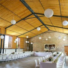 Natalie and Chris celebrated their marriage with a reception at the barn at Rockhaven. They had two long tables to seat their 70 guests on, and named them after their two dogs, Juno and Winnie, as it broke their hearts that their precious pets couldn't share their wedding day with them.The barn was decorated with white paper lanterns and fresh flowers. The décor was kept simple and fresh looking, which worked well with the beautiful surroundings. Silver candelabras added a touch of glamour…