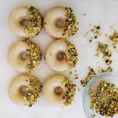 Monday's looking pretty good.  Lemon baked doughnuts, yogurt glaze & pistachios from the #WSTestKitchen's Doughnut Cookbook. Shop with the link in our Instagram profile.