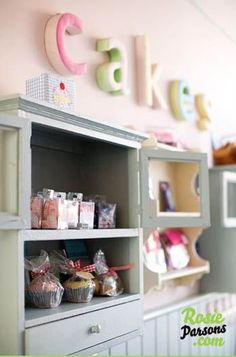 Use a large cabinet to create your craft fair display instead of a table.