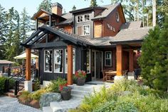 Exterior With Accent Cedar Shake Siding Design Ideas - I love the black or dark grey contrasting with the rich cedar. Even if the cedar faded out to grey it would still look great.