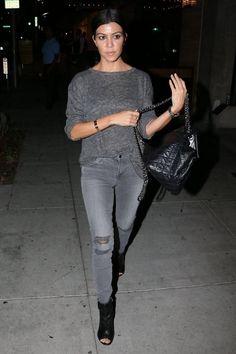 Kourtney Kardashian wearing Chanel CC Lambskin Backpack, J Brand Mid Rise Skinny Jeans in Chrome Mercy and Stuart Weitzman Koko Booties