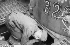 "Heerswerkmeister of the Werkstattkompanie repairing something in the engine compartment of Tiger 323 , during Operation "" Zitadelle "" July 1943"