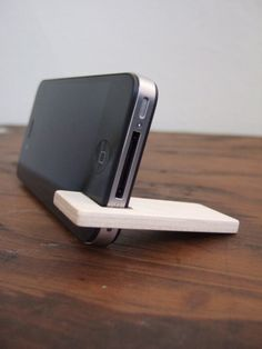 Photo of wood iPhone 4 and 4S stand.  cherry with charcoal.