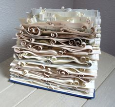 Old catalogs and phonebooks take on a new life in this delicate sculpture. Made in France, this piece of art ($39) is comprised of careful folding techniques. For more book art sculptures, visit Etsy.com/shop/Abadova.