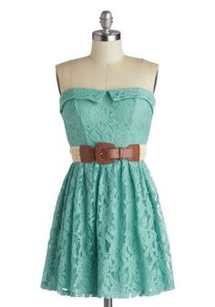Mint green strapless lace dress with a neutral belt. Great summer outfit.