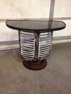 Old tractor grill mounted on tilling disc. Has a 1/8 steel top and chain for a neat and smooth edge.