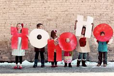 Idea for Christmas Card Photo Pose - Make big letters out of poster board such as JOY, 2012 or PEACE and then each member of the family hold one.