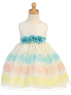 The embroidered organza skirt on this poly silk dress from Lito is available for 60 months to size 10.