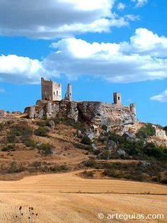 """CASTLES OF SPAIN - Calatañazor, Soria. The name Calatañazor comes from the Arabic 'Qalat al-Nusur' that can mean 'Castle of Vultures'. The castle located in a valley near the town of Calatañazor where it took place in the year 1002, the battle of Calatañazor, the valley is still called """"the valley of blood"""". Almanzor (Abu Aamir Muhammad bin..), the Muslim ruler of Al-Andalus (Islamic Spain) was mortally wounded in this battle."""