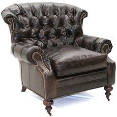 Add some warmth to your room with this chocolate Tufted Leather Club Chair by  Old Hickory Tannery . This handsome tufted club chair is made of top grain leather and solid hardwood with a french dark cherry finish and features a crown nail design. This stylish chair is the perfect addition to any decor.