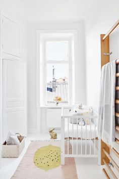 all white bright nursery...