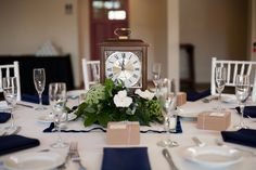 """Love these """"time"""" themed centerpieces- because the groom always asks the bride what time it is! So adorable! // photo by Driver Photo"""