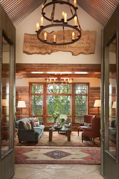 Log home view into great room from front foyer http://kristinpeakeinteriors.com/showcase/project_3.html