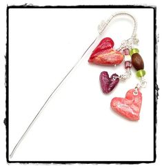 Heart shaped beads made from plastic grocery bags. Used on a bookmark.